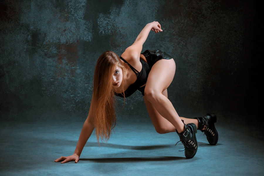Attractive girl dancing twerk in the studio by Volodymyr Melnyk on 500px.com