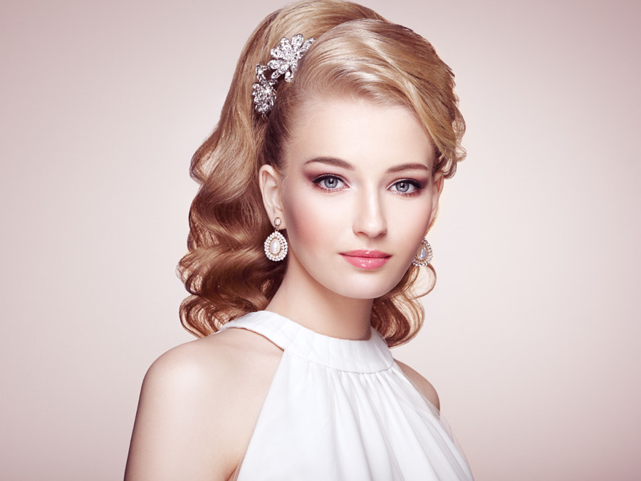 Fashion portrait of young beautiful woman with elegant hairstyle by Oleg Gekman on 500px.com