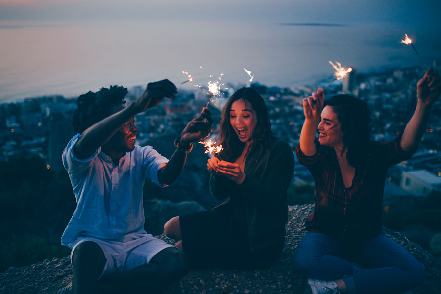 Group of friends celebrating with sparklers at night by Carina König on 500px.com