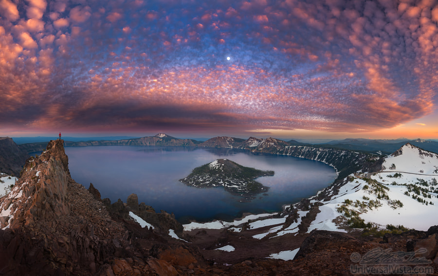Man on hilltop viewing Crater Lake with full moon by William Lee