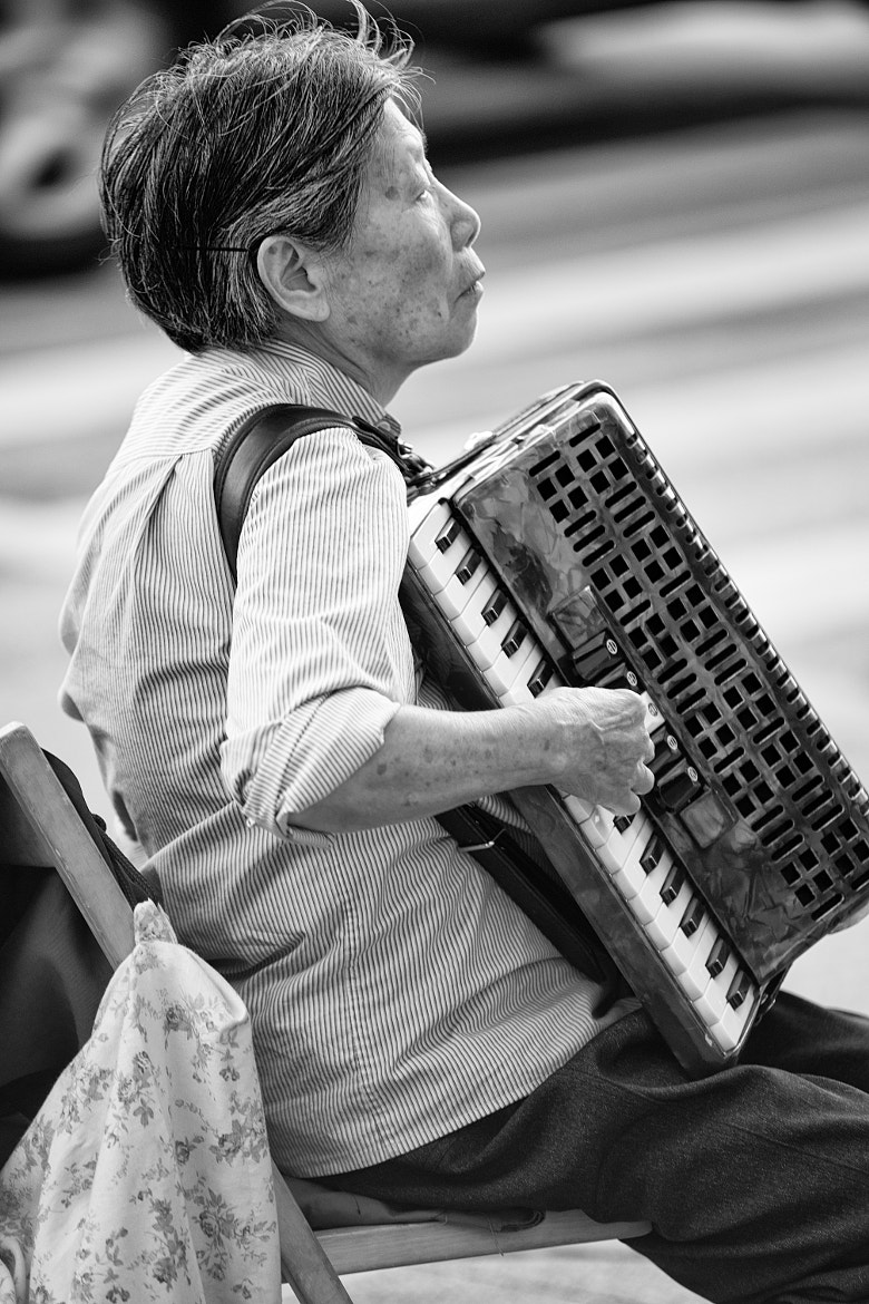Photograph An Accordionist by Victor Garza on 500px