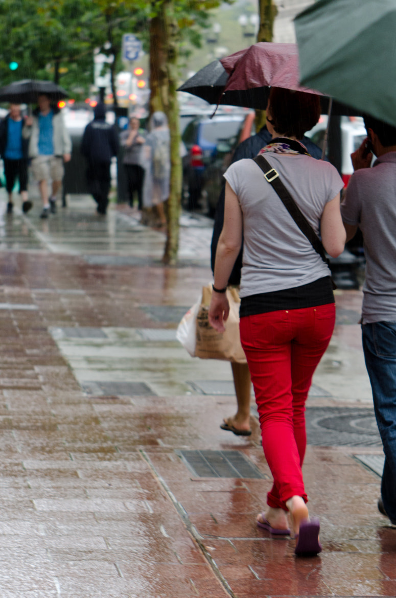 Photograph Red pants in the rain by Colin McMillen on 500px
