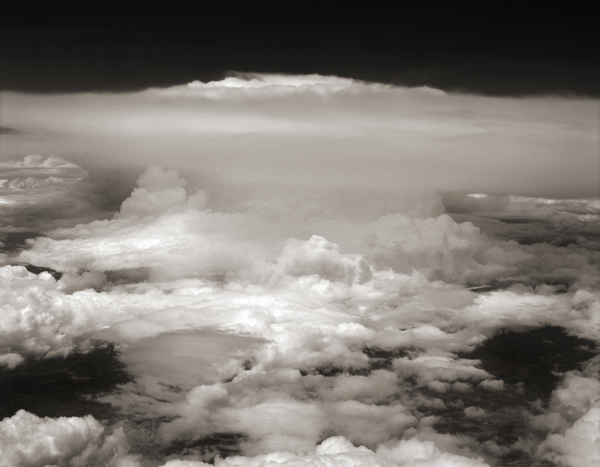Photograph Thunderhead, from Seat 12J, Over Midwestern United States by Austin Granger on 500px