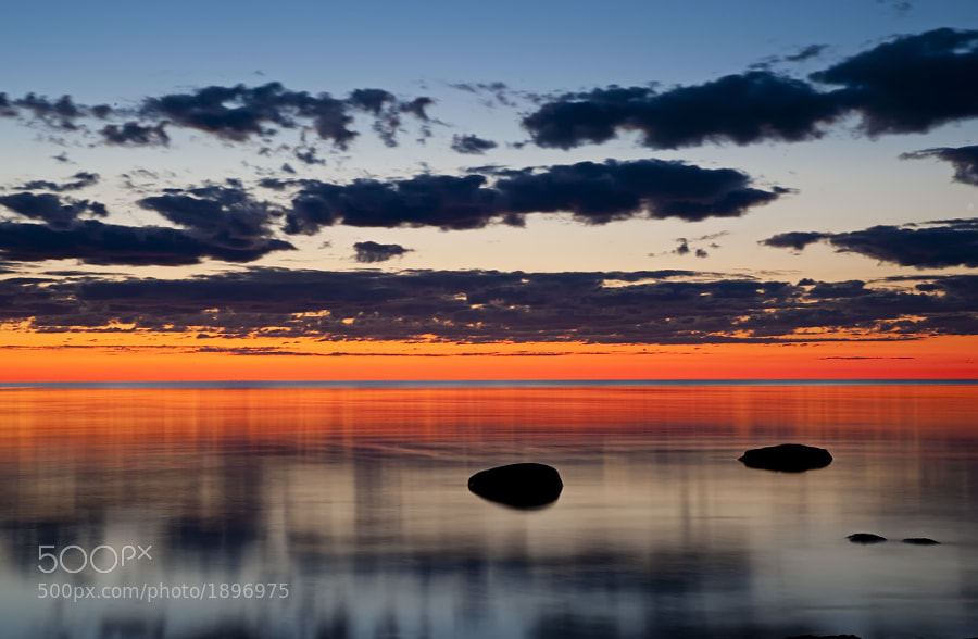 I was blown away by the colors of this sunrise in Door County, Wisconsin.  You can purchase this photo here:  http://fineartamerica.com/featured/just-before-sunrise-scott-norris.html.