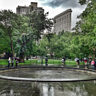 A rainy afternoon in Madison Square Park. Flatiron in the distance.