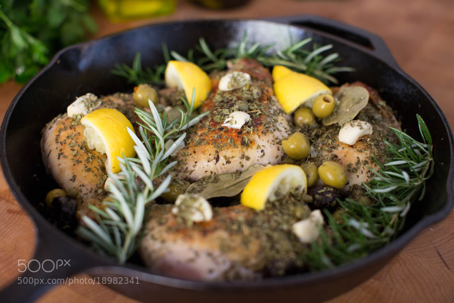 with rosemary, olives, lemon, and garlic
