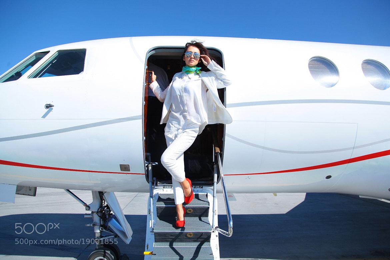 Photograph Sky, Plane and the Girl by Dinara Ratsko on 500px
