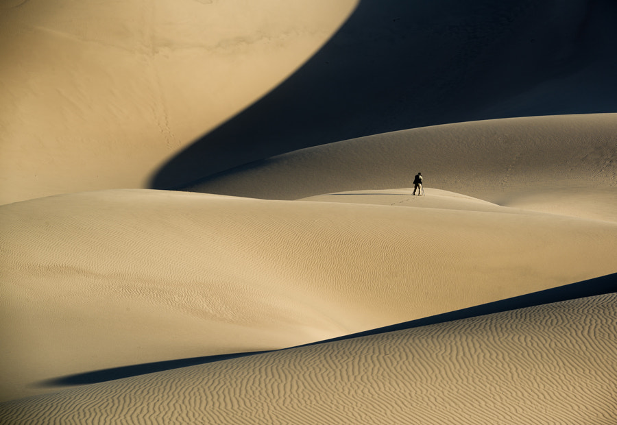 Photographer in desert by Peter Cheung on 500px.com
