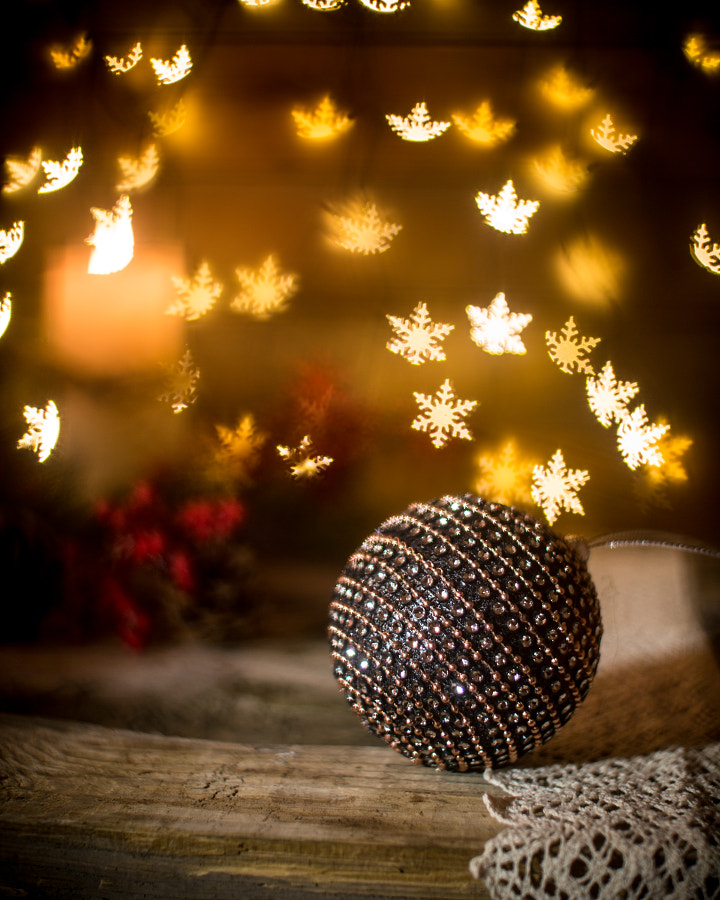 Christmas ornaments with candle in the background by Chinara Rasulova on 500px.com