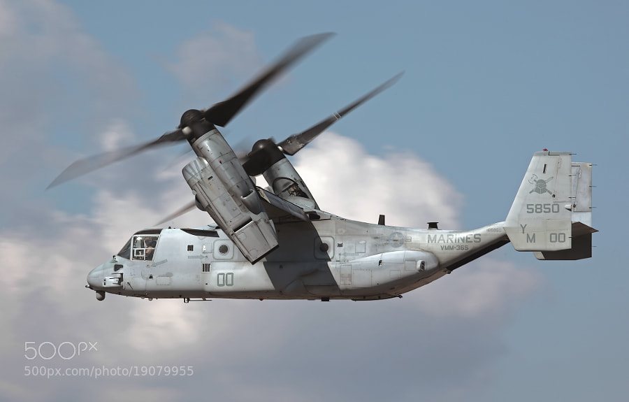 IMHO, aircraft with rotating blades or turning props should be shot at slow shutter speeds to show prop blur.  The blades on the MV-22B Osprey are large resulting in low RPMs requiring slow, challenging shutter speeds to capture prop blur.  That is why these are such a Pain In The Ass (PITA) to photograph.