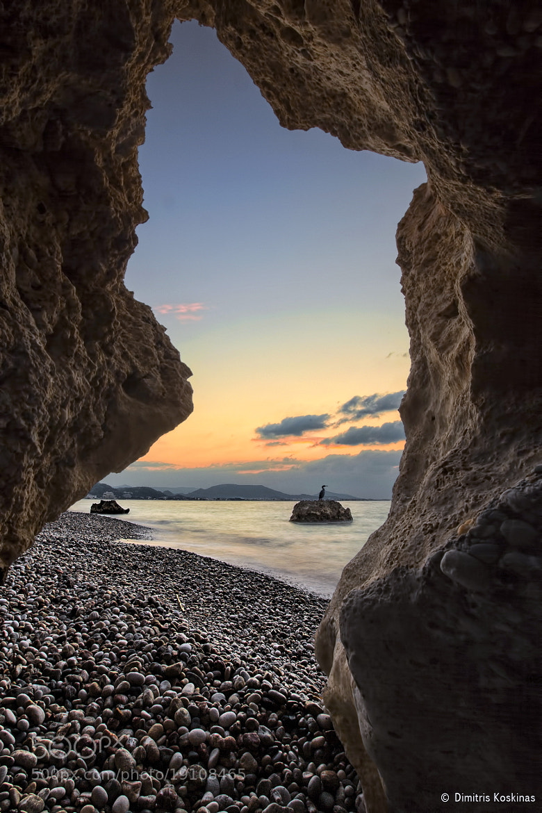 Photograph view thru the rocks by Dimitris Koskinas on 500px