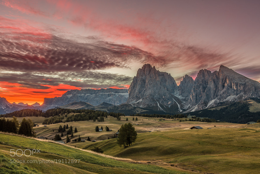 """<a href=""""http://www.hanskrusephotography.com/Workshops/Dolomites-October-7-11-2013/24503434_Pqw9qb#!i=2235292682&k=JFSSHjR&lb=1&s=A"""">See a larger version here</a>  This photo was taken during a photo workshop that I led in the Dolomites October 2012.  The photo is an HDR created from 5 exposures 1 stop apart in order to capture the strongest sunligt right over the edge of the mountains as well as the darker areas. The HDR was created using the 32 bit Photomatix plugin for Lightroom. The resulting 32 bit TIFF file was tone mapped in Lightroom 4.2."""
