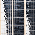 same buildings reflected by an office tower