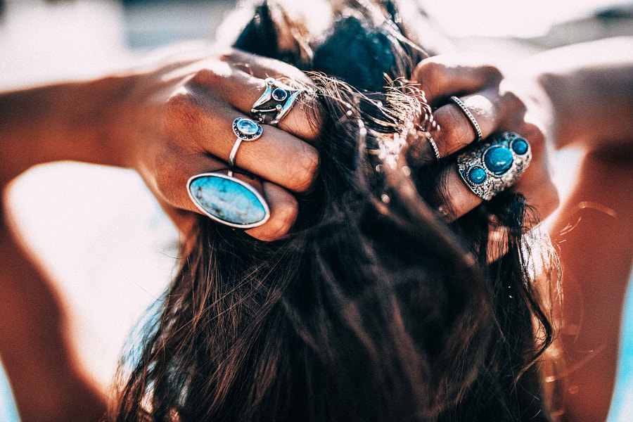 Close up of Women with bohemian style jewellery rings on hands by Carina König on 500px