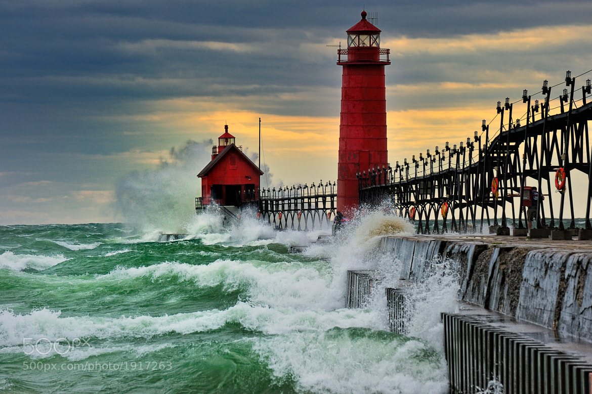 "Photograph ""September Gale"" Grand Haven Breakwater Lighthouse is located in the harbor of Grand Haven, Michigan by John McCormick on 500px"