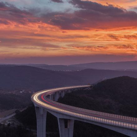 Črni Kal viaduct under  pinky-orange clouds