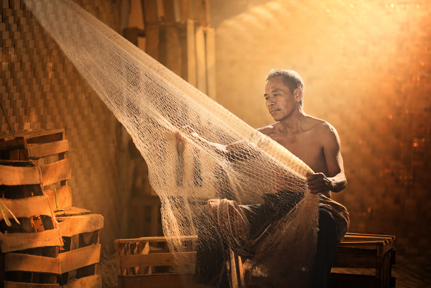 Photograph repairing old fishing nets by JD Ardiansyah on 500px
