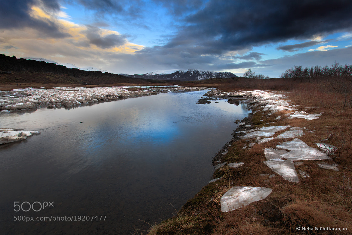 Photograph Sheets of Glass Strewn on a Frosty Stream by Neha & Chittaranjan Desai on 500px