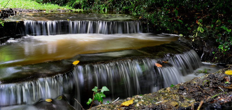 Photograph Mini Waterfall by John Lacey on 500px