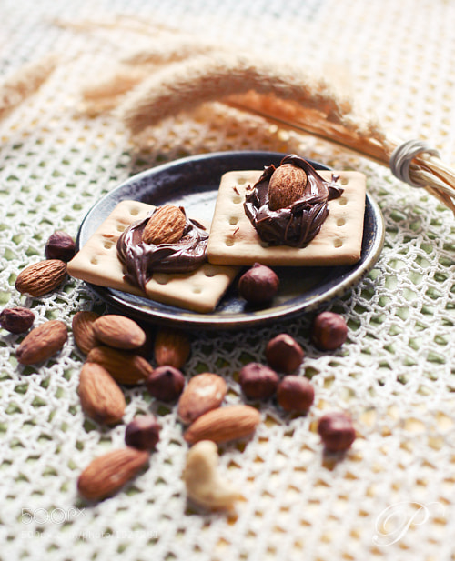 Photograph Water biscuit with nutella by Pauliné H. on 500px