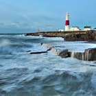 A very windy morning at Portland Bill. Just as i took this a huge wave came over the top of the cliff, soaked me and nearly knocked me off.