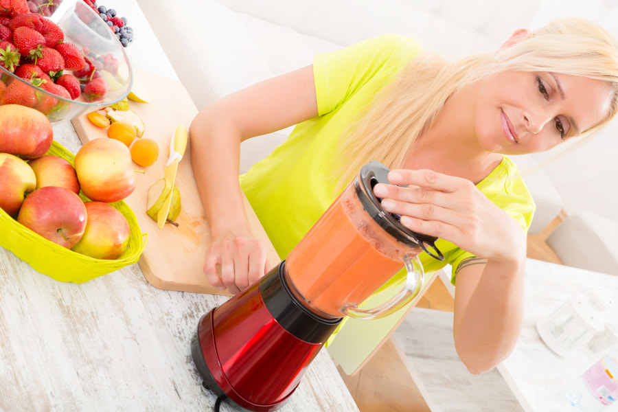 Mature woman blending a smoothie by Michael Osterrieder on 500px.com