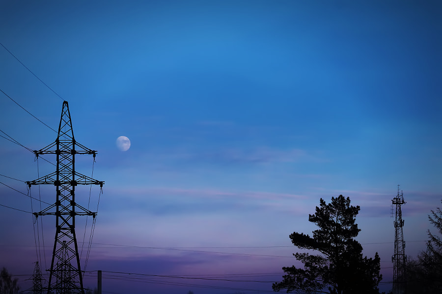 transmission tower on the background of the moon