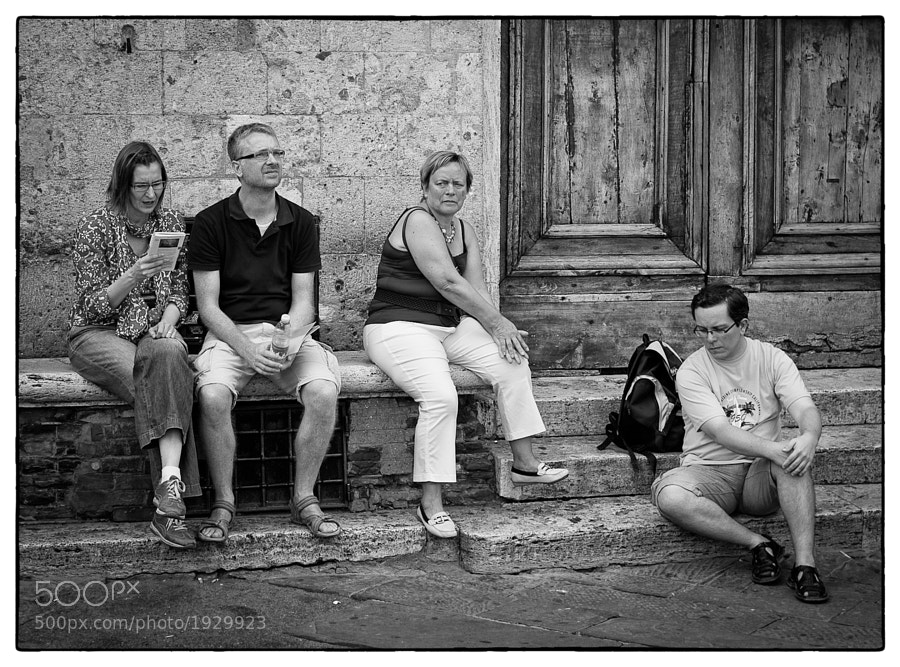 Group of tourists gaze and think