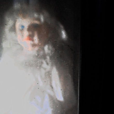 doll behind glass, Canon IXUS 160