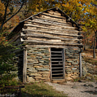 Log and stone building on the William J. Carter Farm nestled high in the Blue Ridge Mountains. Virginia.