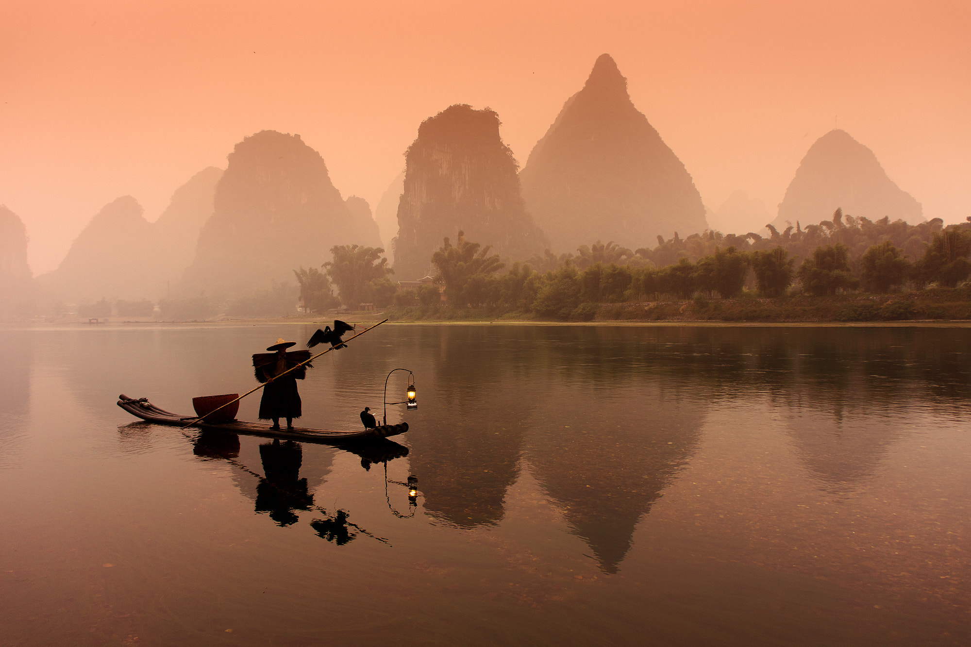 Photograph Cormorant fisherman on Li river #2 by Sergey Kuznetsov on 500px