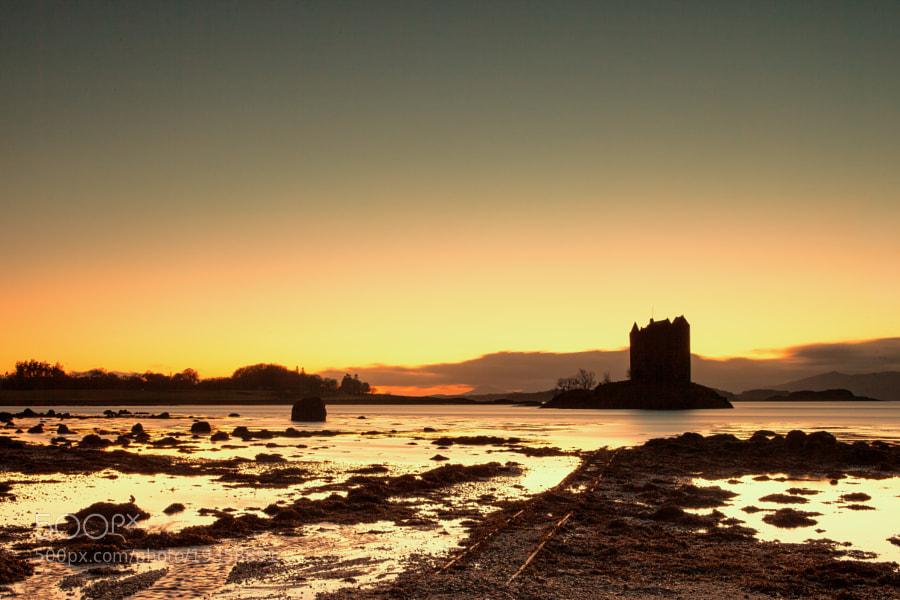 After sunset long-exposure capture of Castle Stalker with more then a bit of white balans adjustment.
