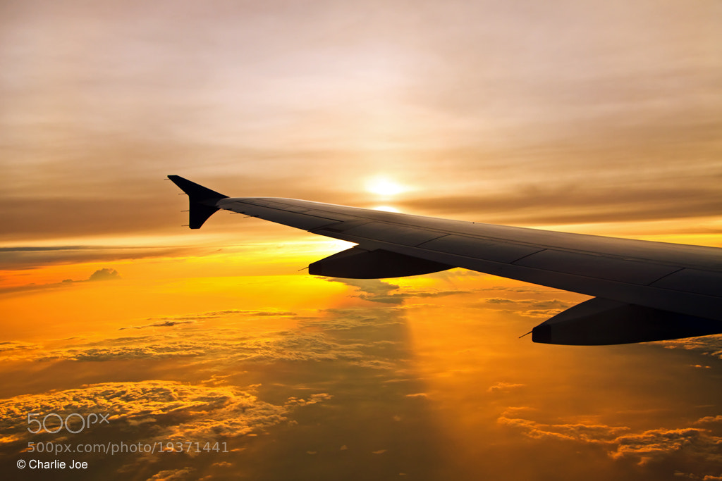 Photograph World beneath the wing... by Charlie Joe on 500px