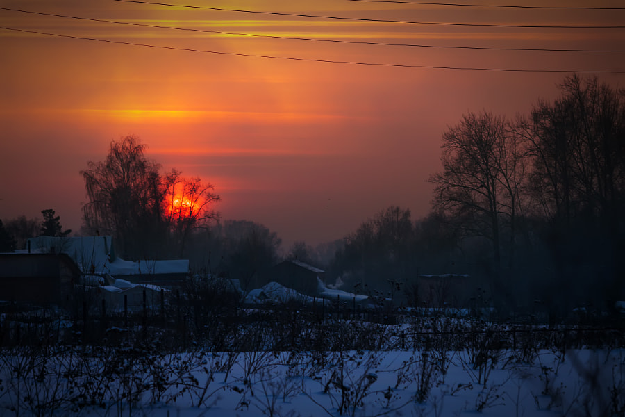 red sunset over the village