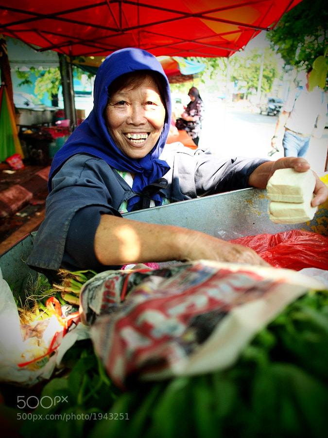 A Chinese vegetables & tofu seller at Kampung Baru, Kuala Lumpur, Malaysia.
