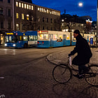 Buses, trams, bicycles, autos, and pedestrians all share the roads in Göteborg, Sweden.