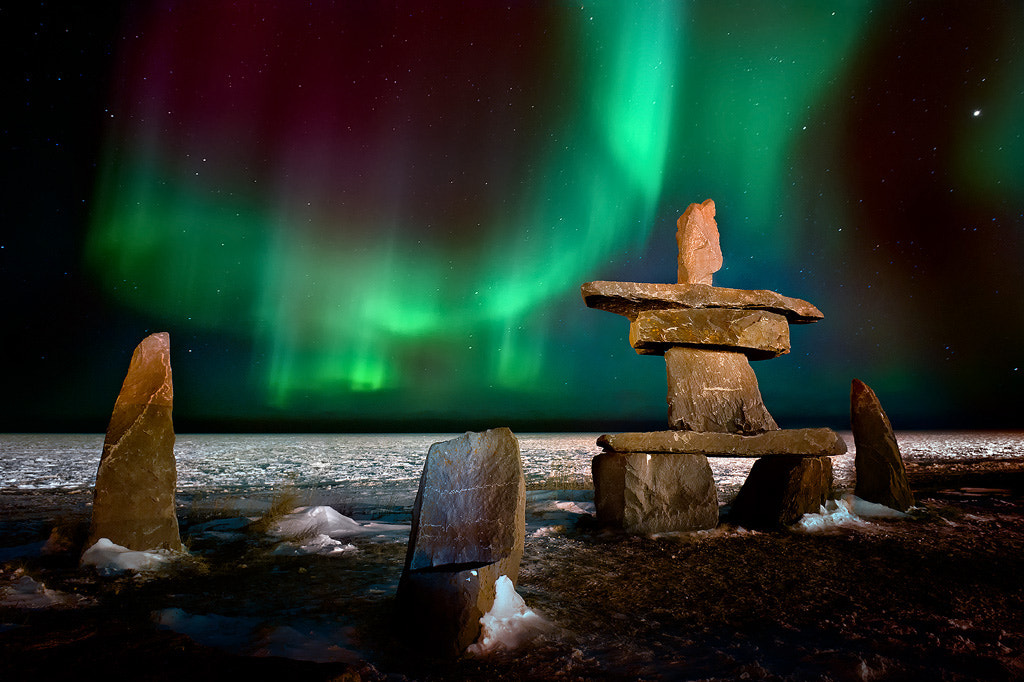 Photograph Northern Lights Over The Inukshuk by Steve Perry on 500px