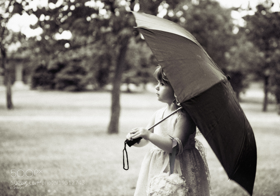 Photograph Flower girl on a rainy day by Rob Bannister on 500px