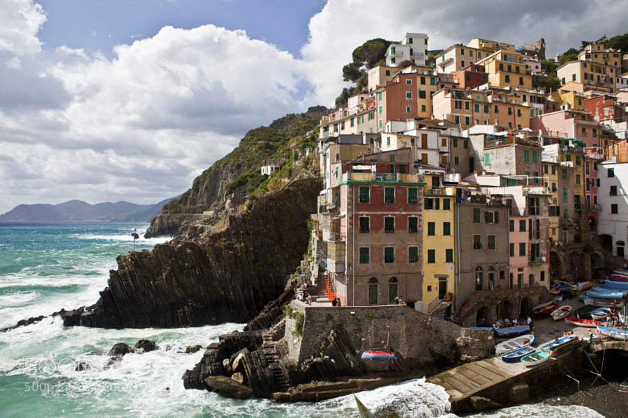 Riomaggiore is a village and comune in the province of La Spezia, situated in a small valley in the Liguria region of Italy. It is the most southern village of the five Cinque Terre, all connected by trail. The water and mountainside have been declared national parks.