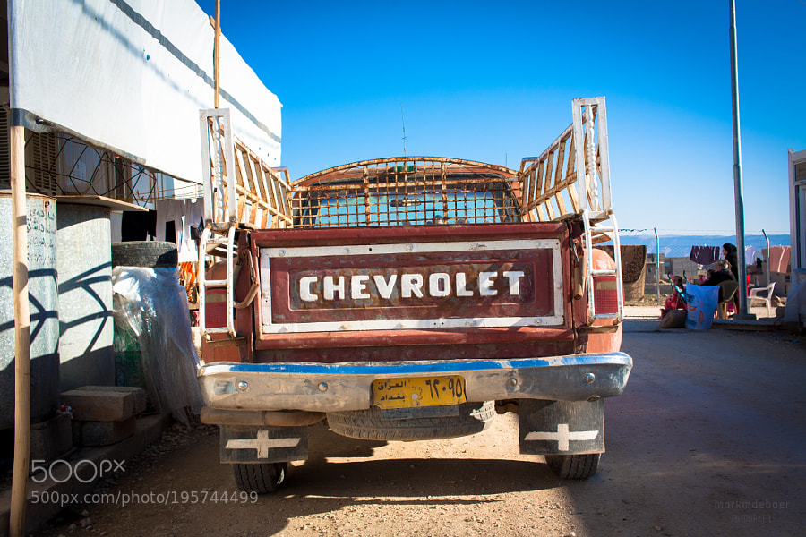 Chevy in a dusty camp