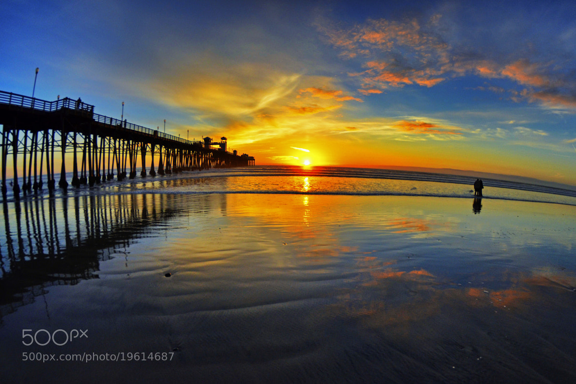 Photograph A Couple Watches the Sunset in Oceanside - December 1, 2012  by Rich Cruse on 500px