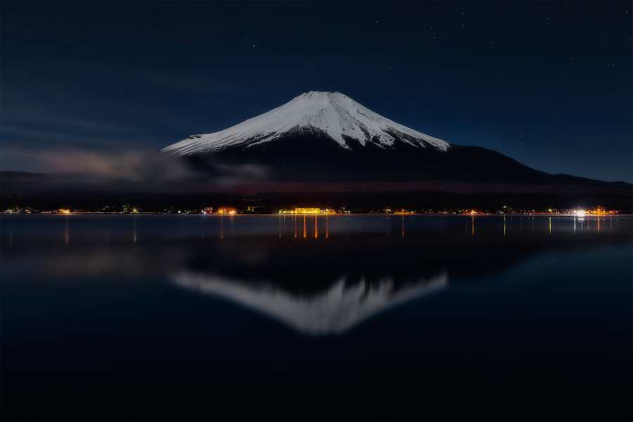 This is an inverted image of snowy Mt.Fuji reflected in lake Yamanakako under the full moon.