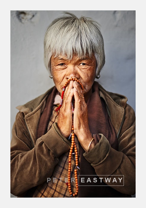 Photograph Praying Woman, Paro by Peter Eastway on 500px