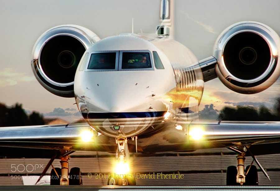 Gulfstream G550 rolling onto runway.  I have a small airport near my home which has lots of executive air traffic.  I like to go to the end of the runway and watch as they do final runups and wait for clearances.  I use a 600mm lens to reach in for the details.  © All of my photographs are Copyrighted and All Rights Reserved. They may not be used or reproduced in any way without my permission.