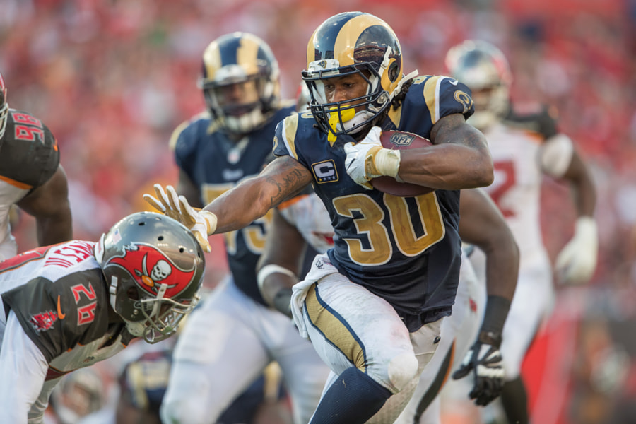 Running back (30) Todd Gurley of the Los Angeles Rams stiff arms against the Tampa Bay Buccaneers... by Jeff Lewis on 500px.com