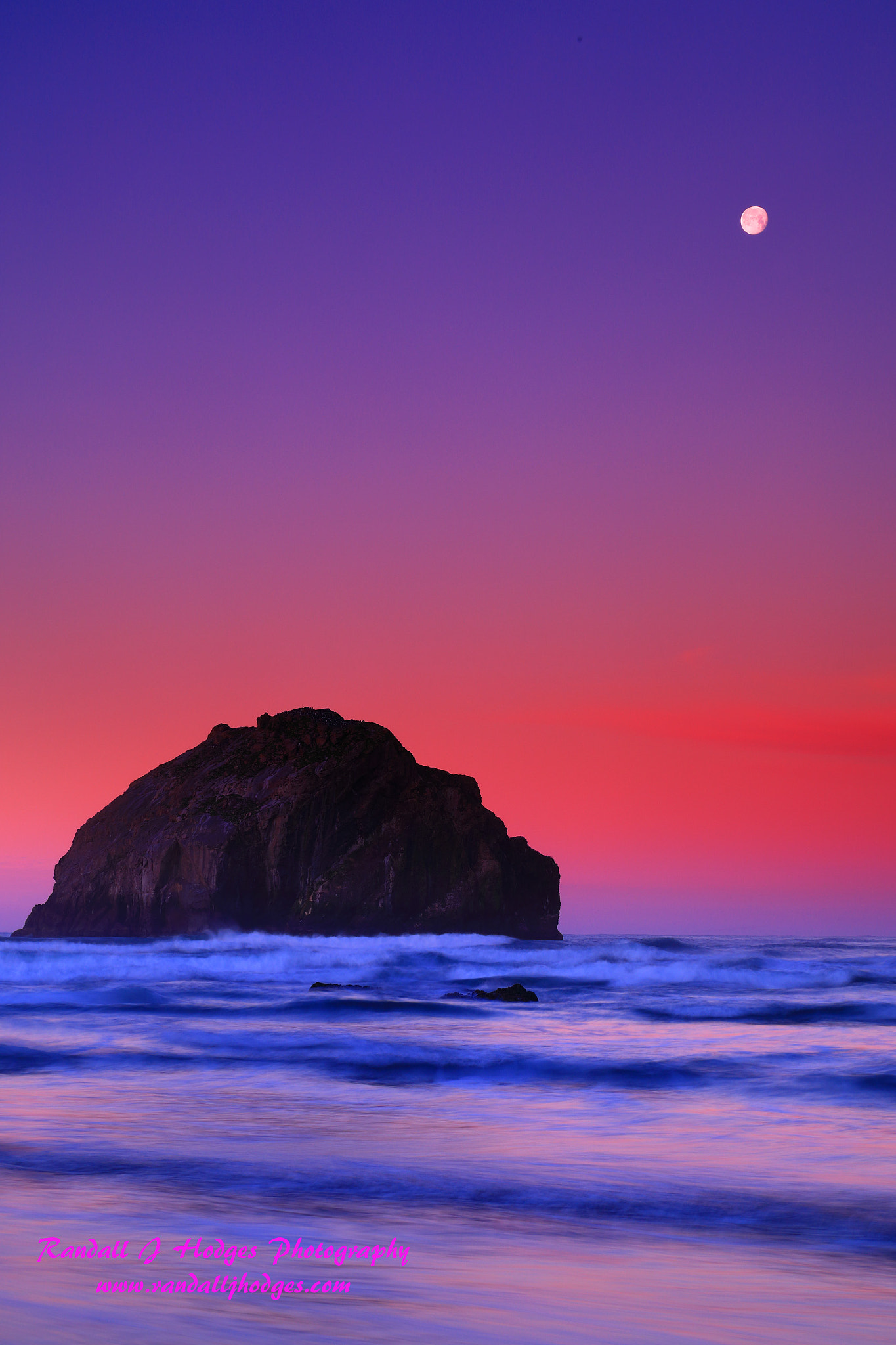 Sunrise Glow With Face Rock and the Moon From Face Rock Beach in