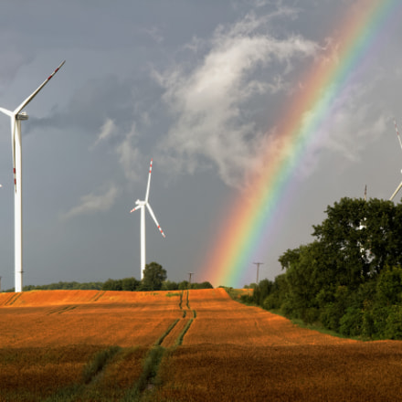 Rainbow inbetween windmills