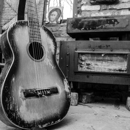 Guitar and a fireplace