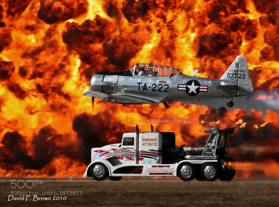 Bill Leff, piloting his T-6 Texan, races the Shockwave Jet Truck to a 'Photo Finish' at the 2010 NAS Pensacola Air Show.
