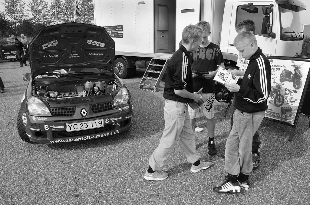 Photograph Boys discussing vehicles by Daniel Hoffmann on 500px